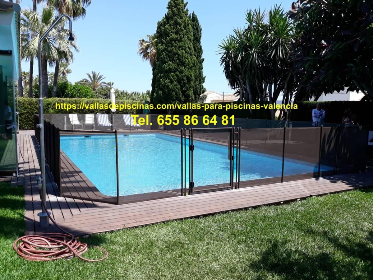 Instalación Vallas piscinas jardin Urbanizacion Coblanca Benidor Valencia color chocolate altura un metro